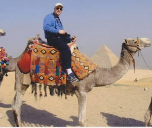 Larry riding camel